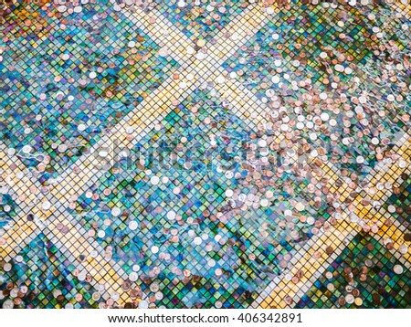 coins in a fountain - stock photo