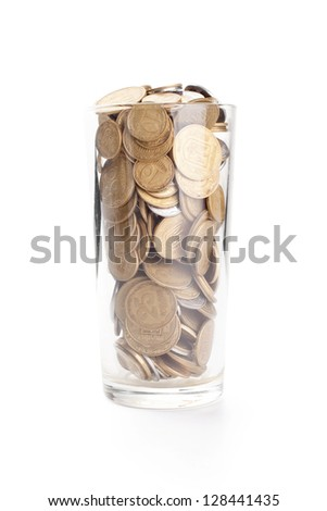 Coins in a glass cup isolated on white background - stock photo