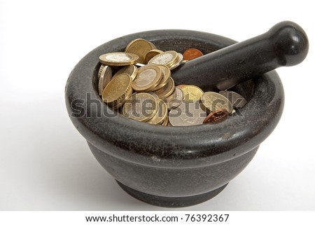 coins in a mortar - stock photo