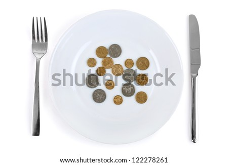 Coins in a plate isolated on a white background - stock photo