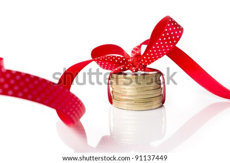 coins in a ribbon, contrast of money and feelings - stock photo