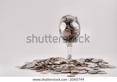 Coins in a Wine Glass - stock photo