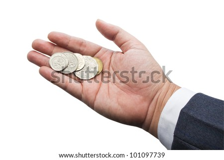 Coins in businessman's hand isolated on white background