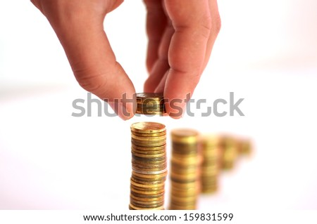 Coins in finger and row stacks them