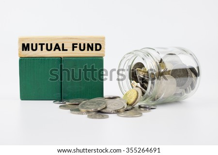 Coins in glass jar with MUTUAL FUND label, financial concept - stock photo