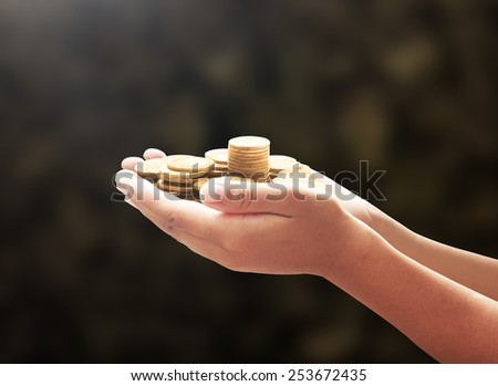 Coins in hands. Gold Donation Investment Fund Financial Support Charity CSR Dividend Market Growth Home House Stock Trust Wealthy Giving Planned Accounting Collection Debt Banking ROI concept. - stock photo