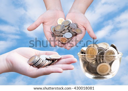 Coins in hands on blue sky,Donation Investment Fund Financial Support Charity  Dividend Market Growth Home House Stock Trust Wealthy Giving Planned Accounting Collection Debt Banking ROI concept - stock photo