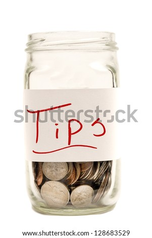 Coins in jar/ Tips Jar  Isolated On White Background/ Vertical shot