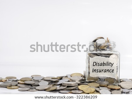coins in jar with disability insurance label in isolated white background; financial concept - stock photo