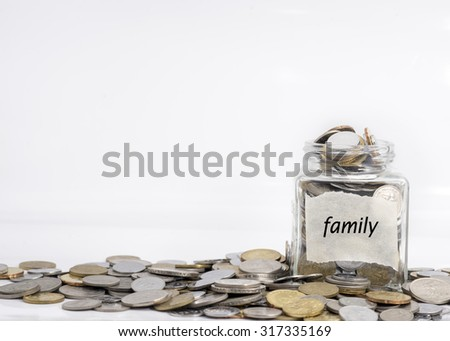 coins in jar with family label in isolated white background; financial concept - stock photo