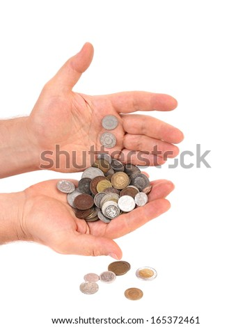 Coins in man hands. Isolated on a white background.