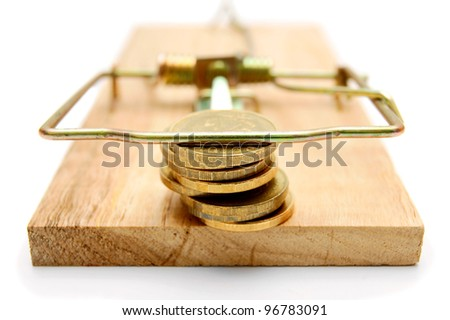 Coins in mousetrap. On white background. - stock photo