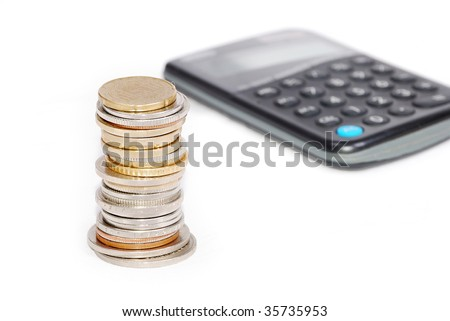 Coins in one place on calculator isolated - stock photo