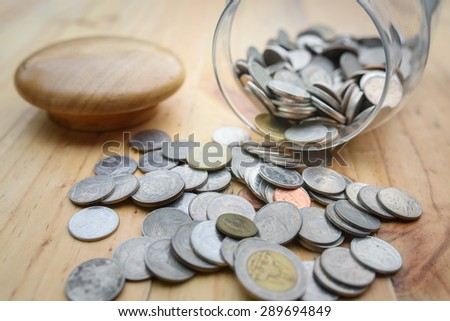 Coins in the jar - stock photo