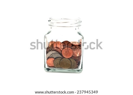 Coins in the jar on white background - stock photo