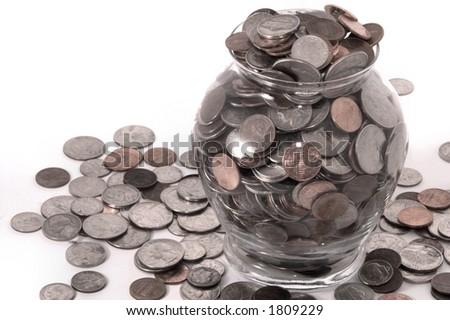 Coins in Vase - stock photo