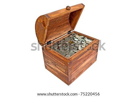 Coins in  wooden casket - stock photo
