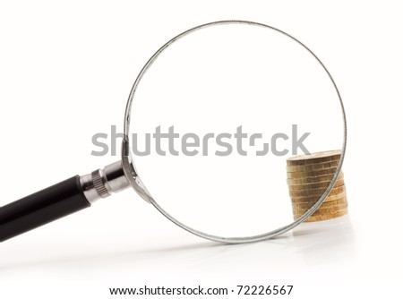 coins increased magnifying glass isolated on white background - stock photo