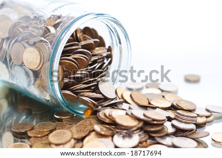 coins jar opened on white closeup - stock photo