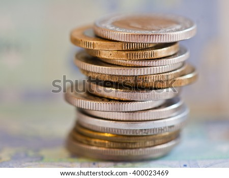 coins of different countries against 20 euro banknote background