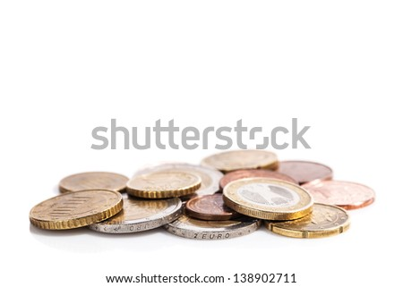 Coins of euro and cents - currency of European market - on a reflective white surface, with copy space - stock photo