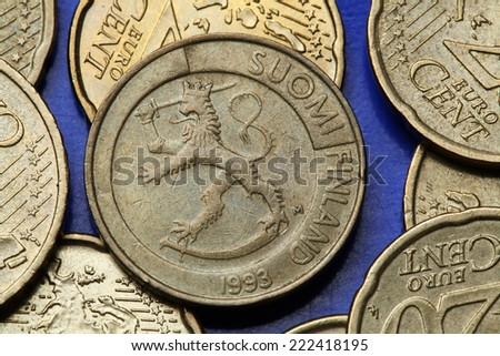 Coins of Finland. Finnish national coat of arms depicted in the old Finnish one markka coin. - stock photo