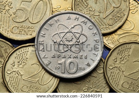 Coins of Greece. Atom, electron and neutron depicted in the old Greek 10 drachma coin.  - stock photo