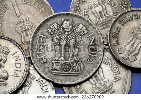 Coins of India. The Sarnath Lion Capital of Ashoka served as the state emblem of India depicted in the Indian one rupee coin.  - stock photo