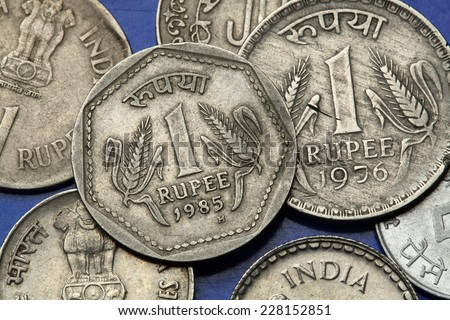 Coins of India. Two stalks of wheat depicted in the Indian one rupee coin. - stock photo