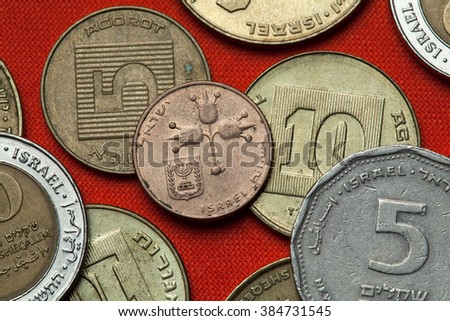 Coins of Israel. Three pomegranates depicted in the Israeli 10 new agorot coin. - stock photo