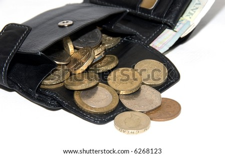 Coins of pounds from mans purse. White background. - stock photo