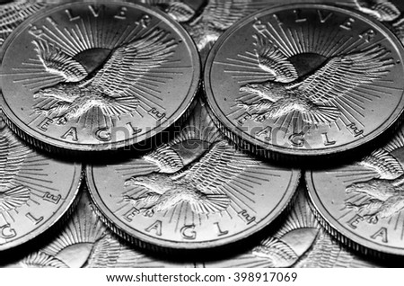 Coins of Silver American Money with word Eagle - stock photo