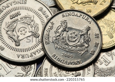 Coins of Singapore. National coat of arms of Singapore depicted in Singapore cent coins.  - stock photo