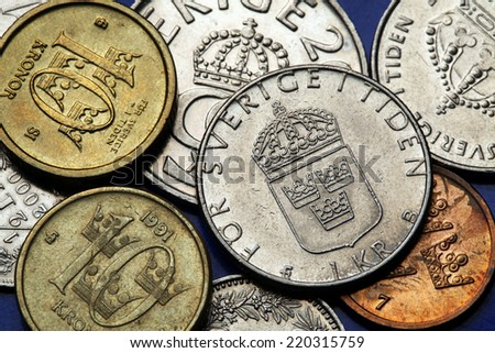 Coins of Sweden. Swedish national coat of arms depicted in Swedish krona coins. - stock photo