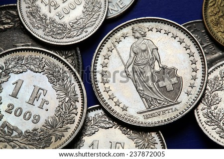Coins of Switzerland. Standing Helvetia depicted in the Swiss one franc coins. - stock photo