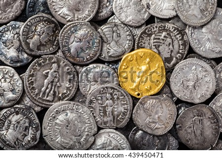 Coins of the Roman Empire, gold and silver. - stock photo