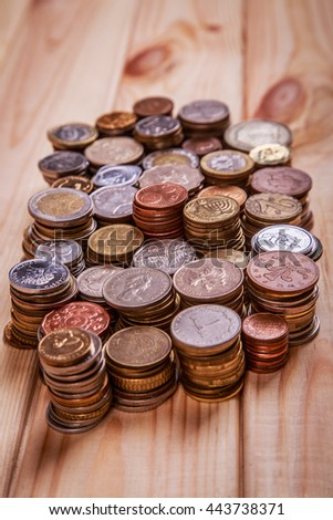 Coins on a wooden background