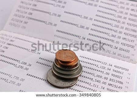 Coins on account account book. - stock photo