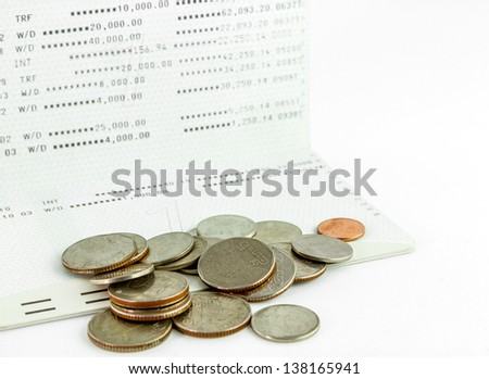 Coins on account book on white background