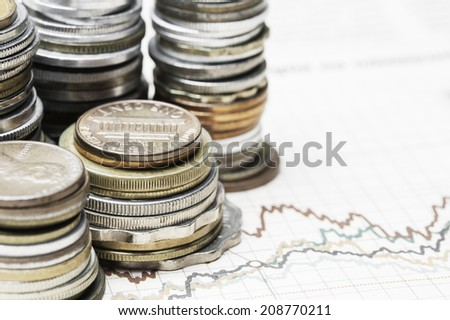 Coins on charts background - stock photo
