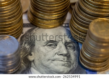coins on 100 Dollar bill banknote closeup - stock photo