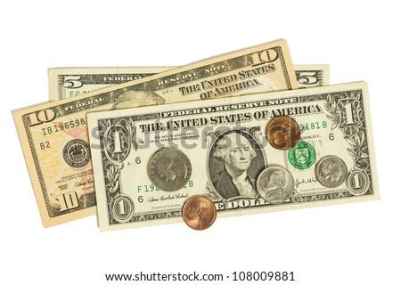 Coins on dollar bills. - stock photo