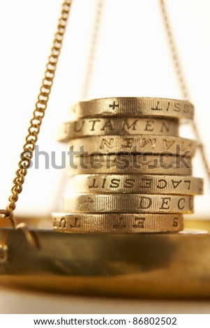 Coins on scale - stock photo