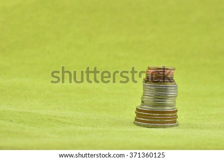 Coins on the  green carpet background.