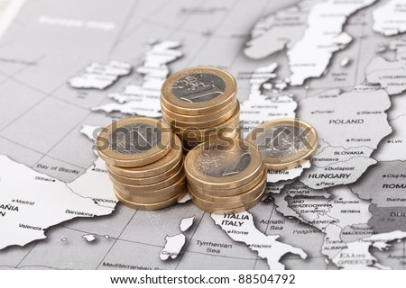 coins on the map - stock photo