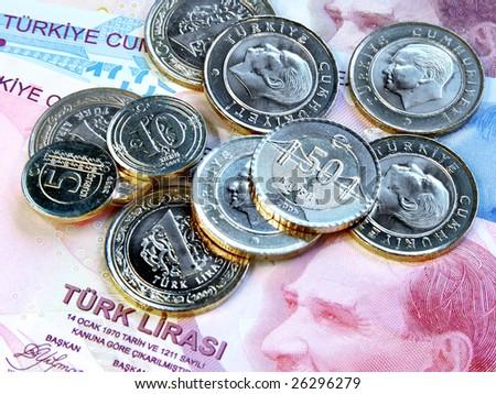 Coins on Turkish bill - stock photo