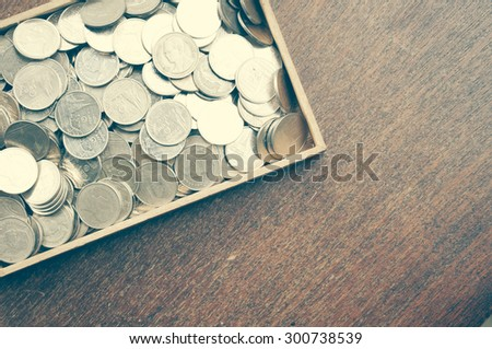 coins on wood with filter effect retro vintage style - stock photo