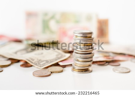 Coins pile with out of focus background - stock photo