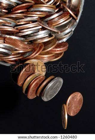 coins pouring from a container frozen in space - stock photo