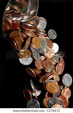 coins pouring from a container like a waterfall, frozen in space - stock photo